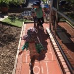 Learning to play HopScotch, promotes development of gross motor skills such as Coordination and balancing while also focusing on furthering children's numeracy knowlage. This experience connects to the EYLF Learning Outcome 3: Children have a strong sense of wellbeing.