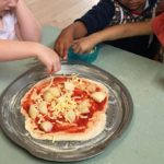 """Participating in cooking experiences helps widen childrens understanding of different cultures, stimulates their senses, """"what does it feel, taste and smell like?"""" while encouraging children to take on further resposibility such as making this Potato and Pumpkin Pizza for their afternoon tea. this activity connects to the EYLF Learning Outcomes: 2 children are connected and contribute to their world and 3 Children have a strong sense of wellbeing."""