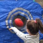 Learning to handball and develop further gross motor and hand eye coordination skills in our DIY football target. This experience connects to the EYLF Learning Outcome 3: Children have a strong sense of wellbeing.