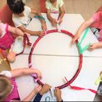 Making our rainbow dream Catcher Allows children to develop their fine motor skills and socialise as they work as a team twisting, tying and beading around an old hoola hoop. This activity promotes sustainable practices and connects to the EYLF Learning Outcome 1: Children have a strong sense of identity.